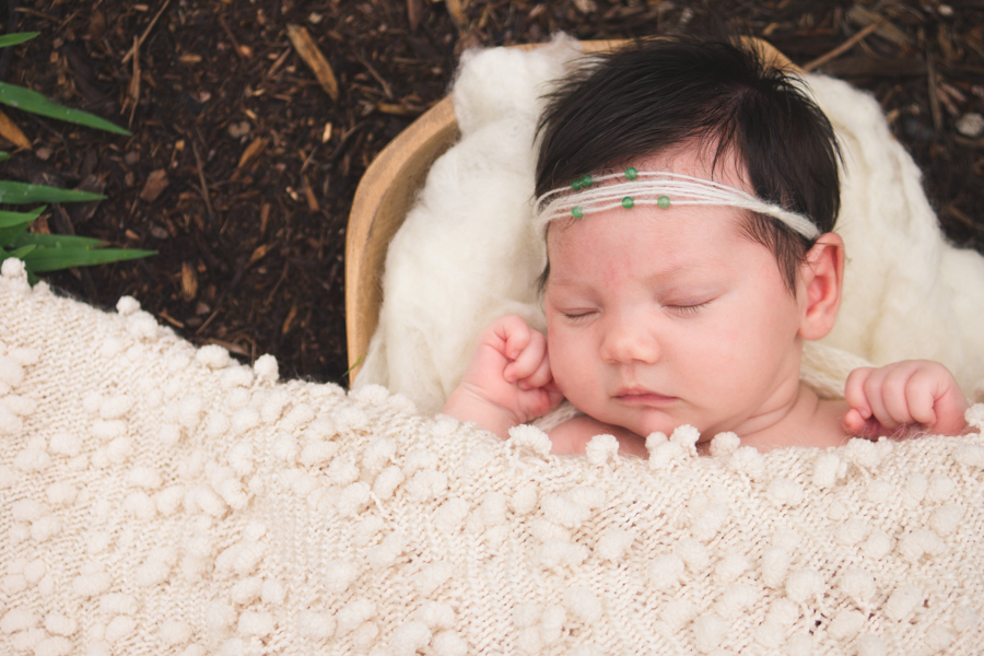 Delicate baby girl outdoor pictures Sleeping in a bowl