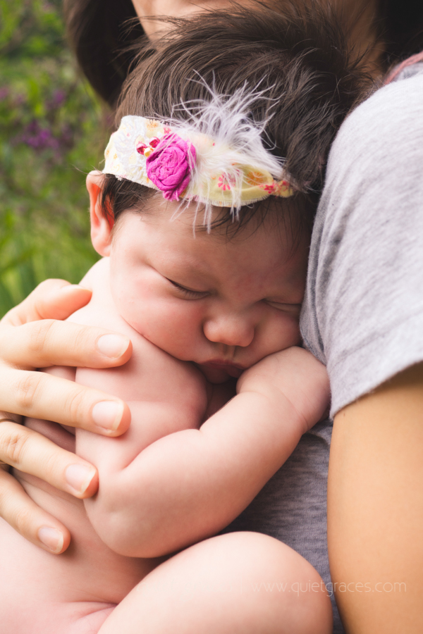 Baby Girl Snuggled closely into mama Greenville SC Newborn pictures