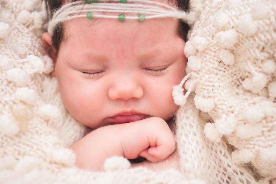 Newborn Girl sleeping ina blanket with a headband on Greer, SC