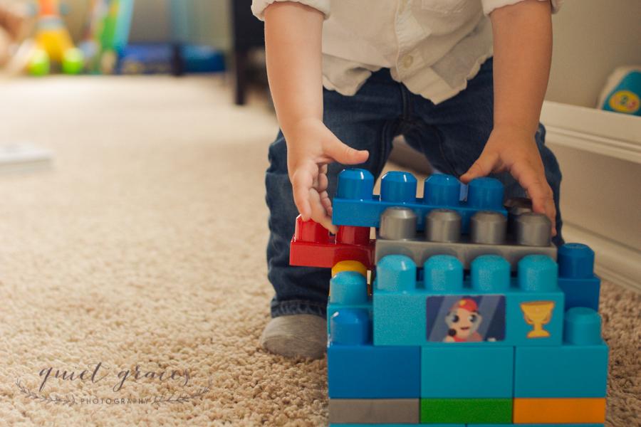 Baby playing with Mega Blocks