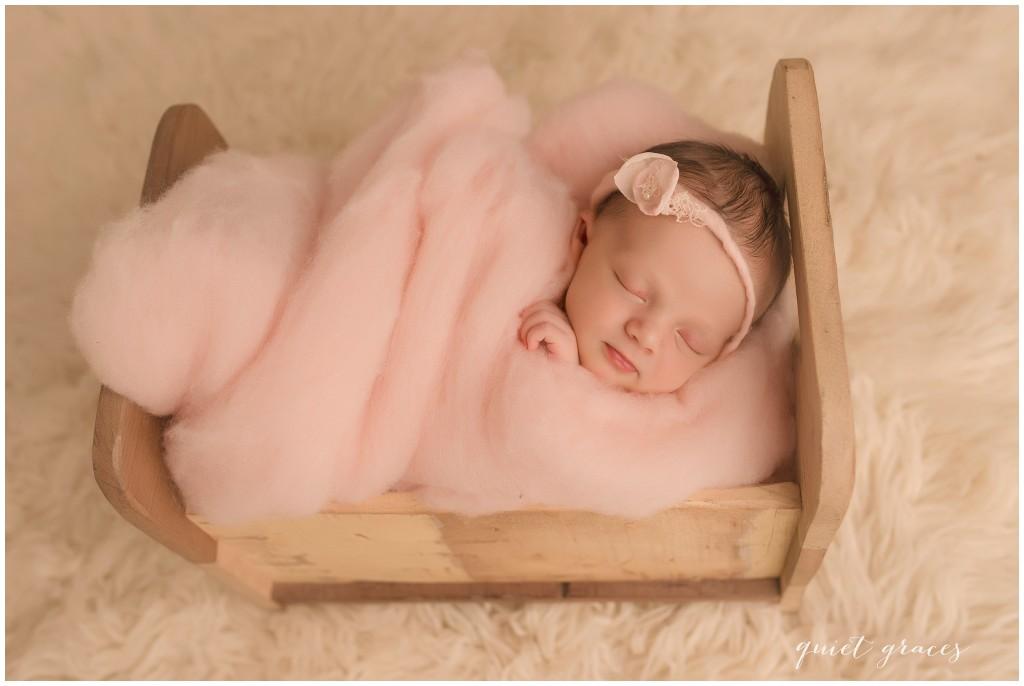 Newborn Baby Sleeping in a Little Bed Photographer Greer SC
