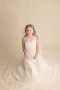Little girl in Mommy's Wedding Dress Pictures in Greenville SC