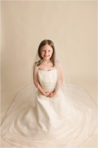 Little girl in Mommy's Wedding Dress Pictures in Simpsonville SC