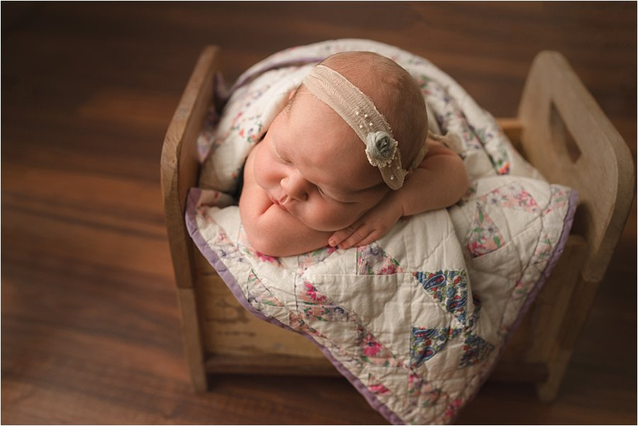 Newborn Baby Photography in little bed with heirloom quilt in Travelers Rest SC